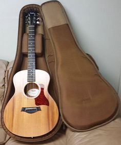 Taylor Mini GS. Not a Martin, but arguably the biggest and finest acoustic sound and playability for the buck. And because of its smaller size, it can be taken aboard aircraft and stowed overhead.