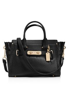 Coach swagger 27 This charmingly compact version of the Coach Swagger carryall is crafted in pebble leather with a refined grain. The long strap snaps on with ease for a hands-free carry; statement belting and double-turnlock hardware provide the swagger. Cheap Coach Handbags, Cheap Coach Bags, Handbags On Sale, Black Handbags, Leather Handbags, Coach Swagger 27, Discount Coach Bags, Fashion Bags, Women's Fashion