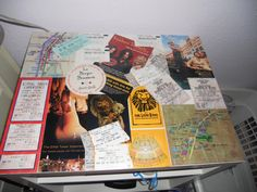 Used an old end table, ticket stubs, event flyers and mod podge. Covered with a clear coat.
