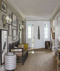 Love this entryway--bench, rug, pictures on the wall--everything.
