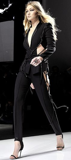 Gigi Hadid walks the Versace spring 2016 couture fashion show in a sexy cutout black pantsuit