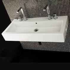 I could see this trough sink mounted on top of a beautiful piece of furniture. I'd use different faucets. I'm not a fan of ultra contemporary faucets.