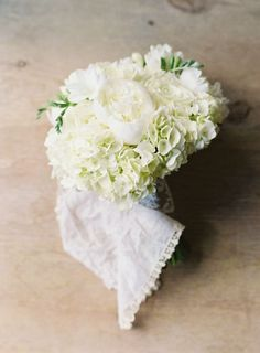 An all-white hydrangea and peony wedding bouquet: http://www.stylemepretty.com/2015/12/07/elegant-vail-mountain-wedding/ | Photography: Brett Heidebrecht - http://brettheidebrecht.com/: