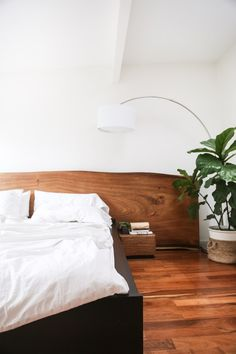 "Headboard is made from a wood called Suar (a fast-growing, non-endangered hardwood), from ""Giant Wood"" in Ubud, Bali / HitherandThither"