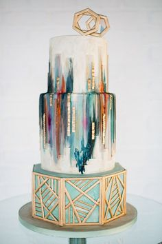 25 Incredibly Beautiful Wedding Cakes That Won 2015: #2. This awesome geometric cake with gold accents.