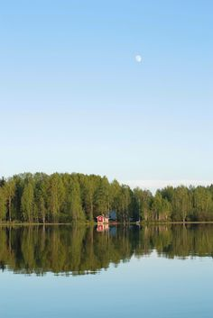 Summer in Finland, sunshine, moon and a cottage