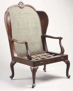*1760 Dutch Folding bed chair (aka porter's chair) at the Metropolitan Museum of Art, New York - Look closely, and you'll see a pair of hinges on the front edge of the seat: this chair could be unfolded and straightened out to form a day bed. Click the pin to see what it looks like then!