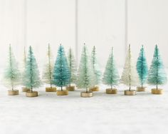 Minty Bottle Brush Trees - One Dozen Bleached 3 Inch Miniature Sisal Trees A set of 12 minty trees for crafts and Christmas decorating. These miniature sisal trees have been bleached to remove most of