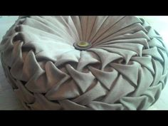 Canadian smocking round cushion by Debbie Shore. I've got to stop watching YouTube....my head is full of creative ideas!