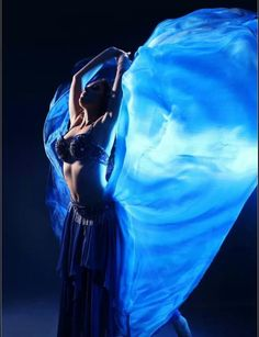 Belly dancing with a gorgeous blue veil! Belly dancing with a veil is something you can master through Belly Dance Lessons Online