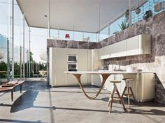 Top 10 modern kitchen designs. This modern interior design kitchen revels in natural light, yet takes it even further with a full set of glass walls and doors that allow for maximum light to enter the kitchen.