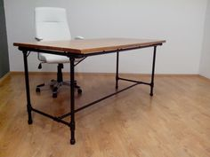Industrial Table. The table combines a steel frame with wooden board made in cooperation with Miroslav Bureš
