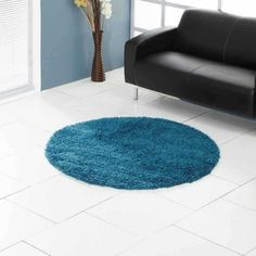 Want to cover your bare floors in a jiffy? Ultimate Comfort Kingfisher Circle Rug offered by Ultimate Rugs can fulfill your desire. Polypropylene made this rug is well known for its stain-resistant, anti-fade and extremely durable fibres. Circle Rug, Kingfisher, Shaggy, Living Spaces, Contemporary, Rugs, Elegant, Simple, Floors