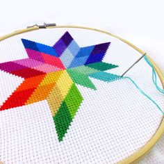 WIP - progress on my quilted star rainbow cross stitch pattern. and sections Rainbow Cross Stitch Pattern Star, Modern Needlepoint Pattern Counted Cross Stitch PDF Modern Embroidery Modern Cross Stitch Rainbow Pattern Simple Cross Stitch, Cross Stitch Flowers, Cross Stitch Geometric, Modern Embroidery, Embroidery Patterns, Stitching Patterns, Needlepoint Patterns, Quilt Patterns, Pattern Fabric