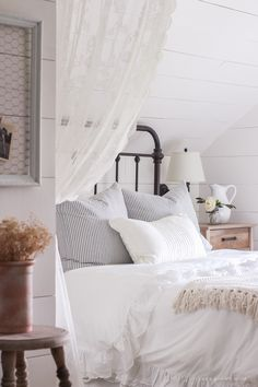 Spring Master Bedroom - A clean and cozy farmhouse master bedroom with tons of vintage charm