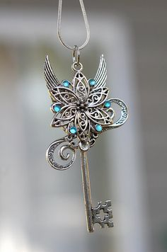 This could be a very pretty tattoo. Celtic Flower Key Necklace. $35.00, via Etsy.