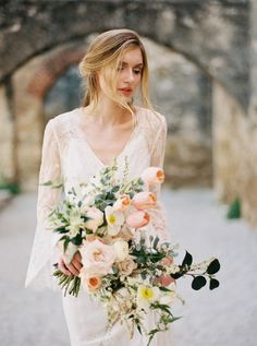 Oversized bouquet filled with peach and pastel blooms