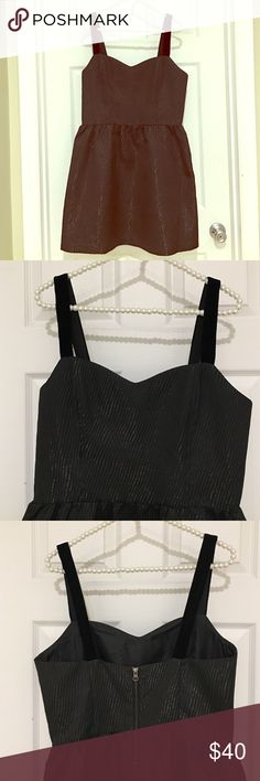 Black cotton/metal fiber blend cocktail dress This cute size L cocktail dress is black on black, with metallic (sparkly, but not silver) threading and raised, lined pattern lending interest and edge. The straps are black velvet, the metal zipper is exposed! Cool for a holiday or other cocktail party. Jack Dresses