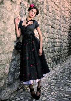 There's a beguiling Spanish vibe to this endlessly elegant black dirndl ensemble