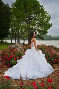 Lovely bride with roses at Travis Pointe on Lake Norman http://travispointenc.com