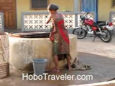 (163) Togo West Africa Girl Pulling Water from Well - YouTube