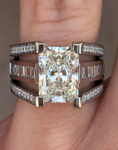 The best of both worlds! This gorgeous ring from our Interlace collection features a radiant cut Diamond accented by both baguette cut and round brilliant cut Diamonds. She will love being able to wear both cuts of diamonds on one stunning ring. #coffinandtrout #jewelry
