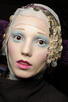 Autumn/Winter 2009-10 John Galliano Pastel cheeks and eyes with white mascara and petal pink lips at John Galliano. Photo By Firstview