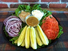 Relish Tray: leaf lettuce, sliced tomatoes, onion, pickles, mayonnaise, deli mustard  honey mustard (a perfect accompaniment to the meat  cheese tray).