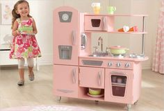 Young chefs are sure to love cooking up fun with our adorable KidKraft Pink Vintage Play Kitchen! This vintage play kitchen has doors that open and close, knobs that click and turn and plenty of convenient storage space.