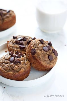 Banana muffins made with wholesome ingredients and a few chocolate chips because YES! Easy-to-make and ready in 30 minutes from start to finish!