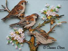 Quilling about flowers and animals: The name of artist is written below