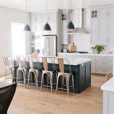 Kitchen w/ Dark Grey Island & Stools and White Cabinets w/ Hardwood Floor | House of Jade Interiors