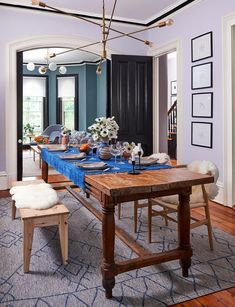 Wood dining chairs and benches look sleek, but they can be uncomfortable. To add a cozier touch to wood furniture, borrow a faux sheepskin throw from the living room to drape across the seat or backrest. #decorideas #upcycledecor #homedecor #diningroom #bhg