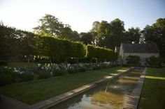 """Jinny Blom's gardens at Temple Guiting, a 15th-century manor in Gloucestershire, England, won her a Pinnacle Award, with dry-stone walls that divide the 14-acre site into 18 """"rooms,"""" each with a distinct style and story to tell."""