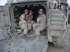 Three female airmen in tank, circa 2003 - The Betty H. Carter Women Veterans Historical Project - UNCG University Archives
