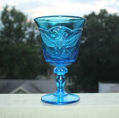 L.E. Smith blue glass goblet with prominent eagle shield on both sides. Lip curves outward.  Dimensions: 6.25 tall, 4 across top  If youd like to