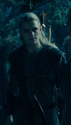 Legolas. The original costume he was to wear before Orlando Bloom asked for something more tailored and regal, still appears in part of the Lorien scene.