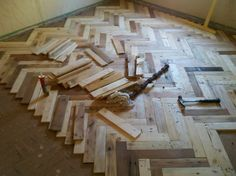 herringbone pallet wood floor.  I adore the differences between the coloration of the weathered and newer woods!