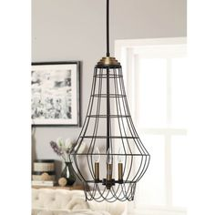 Put passion into your place with this enchanting three-light chandelier from Birdie Cage. This industrial-chic iron chandelier makes high quality and durability a standard with its sustainable wire me