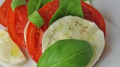 Because this salad is so simple, fresh, top-quality tomatoes and mozzarella are important.   Ingredients 4 large ripe tomatoes, sliced 1/4 inch thick 1 pound fresh mozzarella cheese, sliced 1/4 inch thick 1/3 cup fresh basil leaves   3 tablespoons extra virgin olive oil fine sea salt to taste freshly ground black pepper to taste