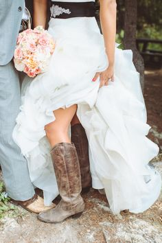 Vera Wang getting cozy with cowboy boots!  Photography By / paperantler.com, Floral Design By / sweetpea-flowers.com #CowboyBoots #CowgirlBoots #Wedding #WesternWedding #CountryWedding #Bride