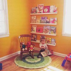 Toddler reading corner, orange bedroom, orange toddler room, boy room, reading nook, floating shelves, book shelves, displaying books, toddler bedreoom, books, chrochet rug, new house inspiration, kid decorating, decorating in progress
