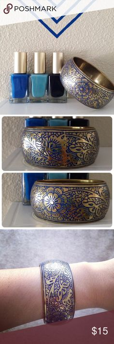 """Patterned Bronze & Blue Thick Bracelet Bronze/gold tone bracelet with dark blue floral design. About 8"""" in circumference. Add it to your arm candy collection.  **Listed as Anthropologie for visibility only.** Thanks for looking! Anthropologie Jewelry Bracelets"""