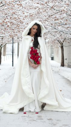 This cape is designed by Cape & Crown Creations located in USA Sold on https://www.etsy.com/shop/capeandcrown13 Princess Bridal Cape 96 inch Ivory / Ivory Satin with Fur Trim Wedding Cloak Handmade in USA $250. https://www.etsy.com/listing/118326669/princess-bridal-cape-96-inch-ivory-ivory Please check out my Etsy shop for winter bridal capes: capeandcrown13