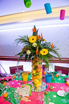 dont like the flower colors but like the fruit in the vase idea Caribbean Tropical Beach Party table displays & 101 Easy-to-Make Baby Shower Centerpieces | Pinterest | Thesis ...