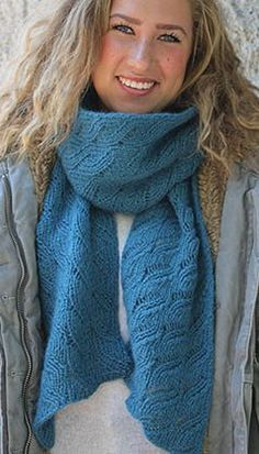 Knitting Pattern Lacy Leaves Scarf - This lovely, elegant and lacy scarf is made with easy repeats, making it a great project for the novice lace knitter.