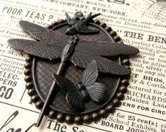 DIY Dragonfly pendant. See FallenAngelBrass on Etsy for stampings /equipment.