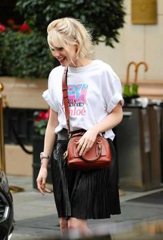 Lucy Boynton in a white t-shirt and knee-length black flared leather skirt with a brown purse leaving her hotel in Paris Celebrity Updates, Celebrity Style, Lucy Boynton, White Tees, Cut And Color, Casual Looks, Leather Skirt, Short Hair Styles, Cool Outfits
