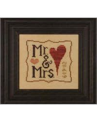 cross stitch - mr and mrs. Can I just buy this? Anything that involves yarn or thread is usually over my head ;)