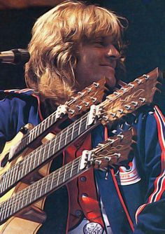 John Paul Jones - Led Zeppelin. Where would we be without without multi-necked guitars? Bad for the back, great for the ears.